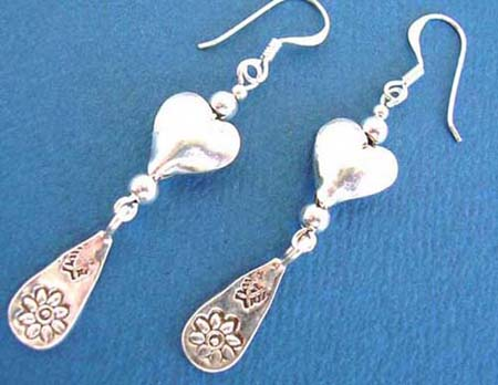fish hook sterling silver puff heart earring holding a water-drop