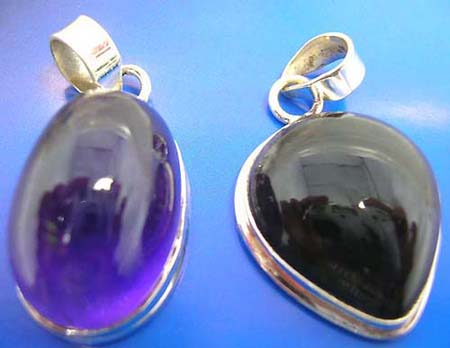 sterling silver pendant with assorted geometrical design amethyst stone inlaid, around edge, assorted design randomly pick