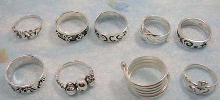 sterling silver ring in assorted design, randomly picked by our workers