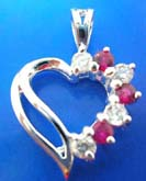 Sterling silver pendant in  heart love outline with 4 mini pinkish and clear cz stone embedded on one side